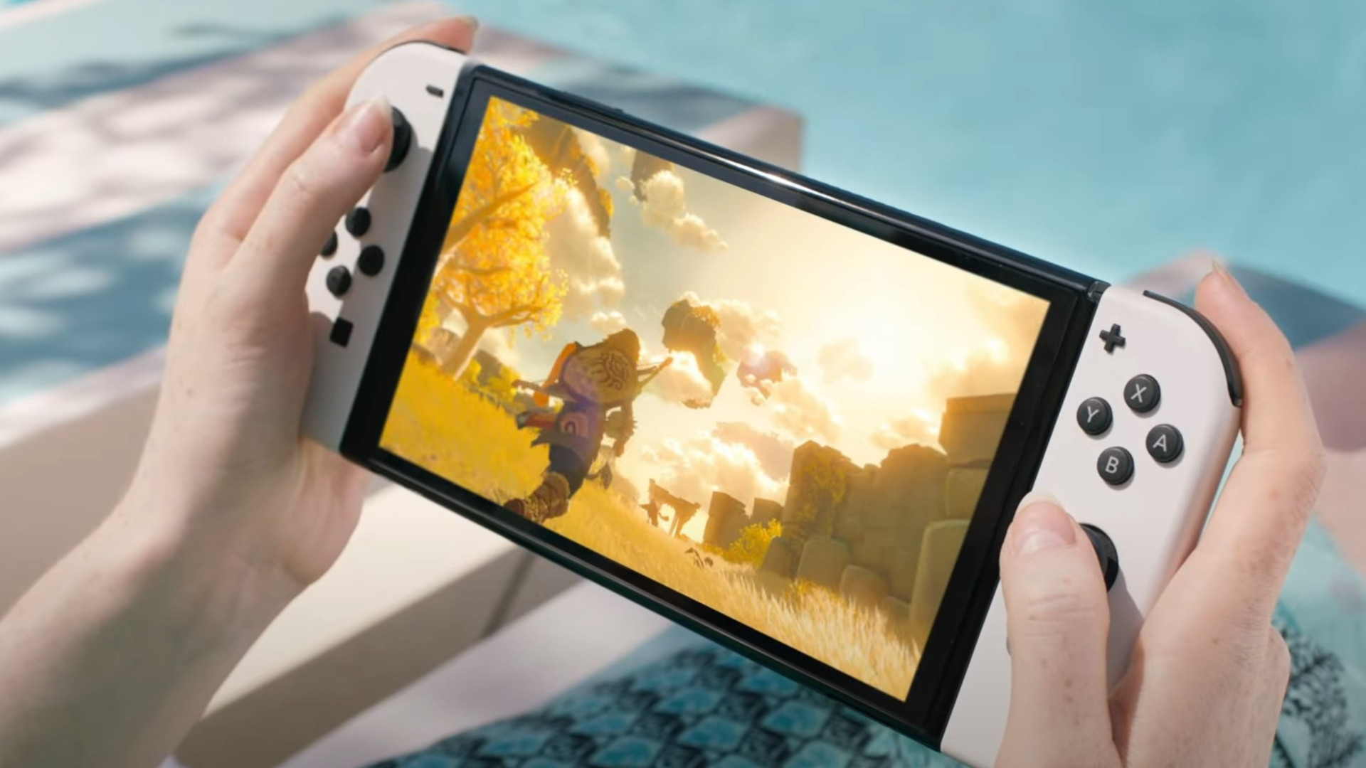 Press image of the Nintendo Switch OLED showing Breath of the Wild 2
